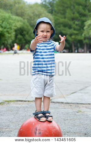 Child Standing On Concrete Hemisphere