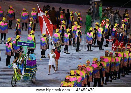RIO DE JANEIRO, BRAZIL - AUGUST 5, 2016: Tennis player Caroline Wozniacki carrying the Danish flag leading the Denmark Olympic team in the Rio 2016 Opening Ceremony at Maracana Stadium