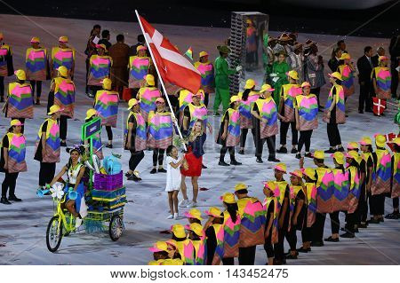 RIO DE JANEIRO, BRAZIL - AUGUST 5, 2016: Tennis player Caroline Wozniacki carrying the Danish flag leading the Denmark Olympic team in the Rio 2016 Opening Ceremony at Maracana Stadium