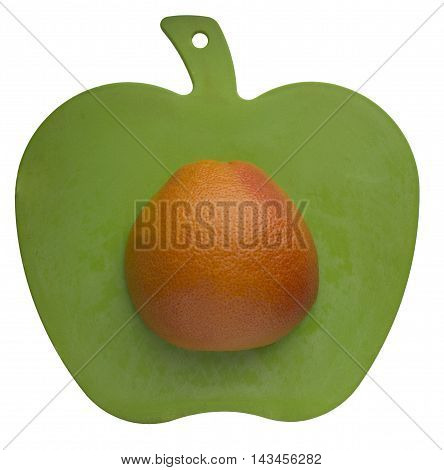 orange on apple shape carving board isolated