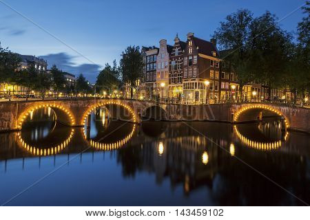 View of Amsterdam Canal by night. Netherlands