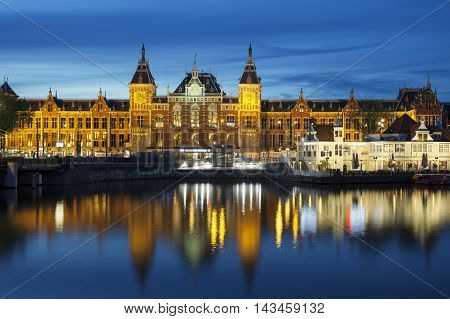 AMSTERDAM - JULY 6 2016: Central Station on July 6 2016 in Amsterdam. Central Station is the central railway station of Amsterdam and is used by 250000 passengers a day.