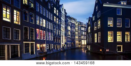 Famous view of Amsterdam at night Netherlands