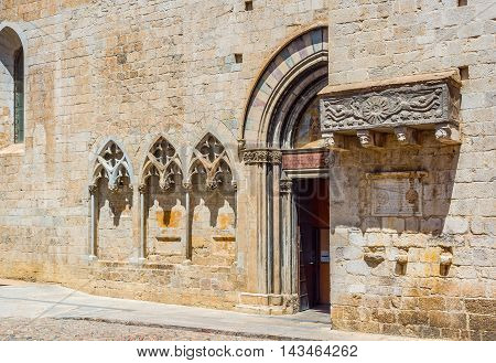 XII century sarcophagus in south facade of Basilica of Sant Feliu in Gerona. Costa Brava Catalonia Spain.