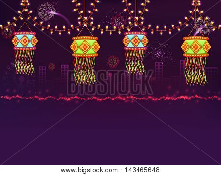 Colourful glossy hanging Diwali Lamps (Kandils) with lighting decoration on night urban city background for Indian Festival of Lights Celebration.