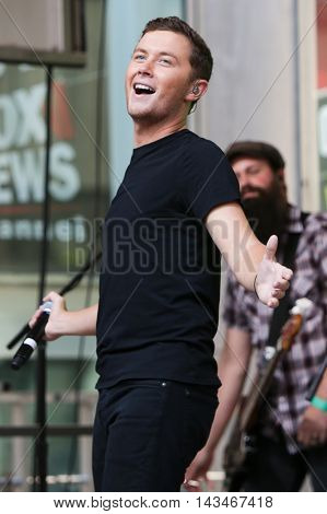 NEW YORK-JUL 31: Country music artist Scotty McCreery performs at Fox and Friends' All-American Summer Concert Series on the corner of 48th Street and 6th Avenue on July 31, 2015 in New York City.