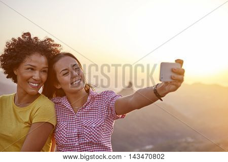 Girl Friends Taking A Selfie Smiling