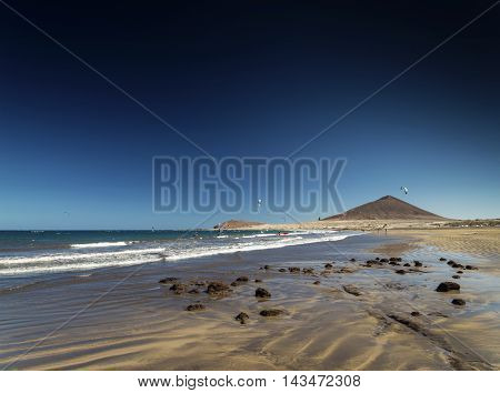 el medano tourist beach and montana roja famous landscape in tenerife spain