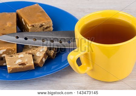 Pieces Of Sherbet With Peanut And Raisins, Knife, Tea