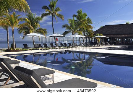 DENARAU, FIJI - Feb 12 2008: Pool and palm trees at resort in Fiji