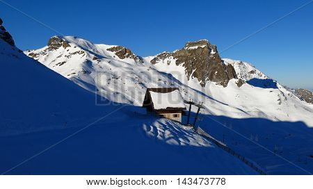 Station of a chair-lift and mountains in the Flumserberg ski area Switzerland.