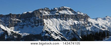 Mt Hochfinsler mountain in Switzerland. View from the Flumserberg ski area. Winter scene.