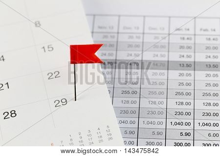 Red Pins to Wildcats on the calendar beside the Twenty-nine number of month in business concept.