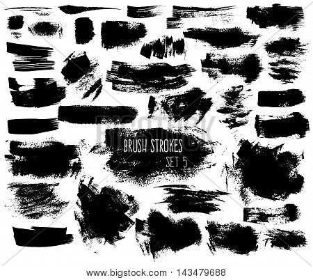 Expressive ink spots of black color on white background. Different brush strokes and shapeless scribbles. Isolated decorative elements for banners.