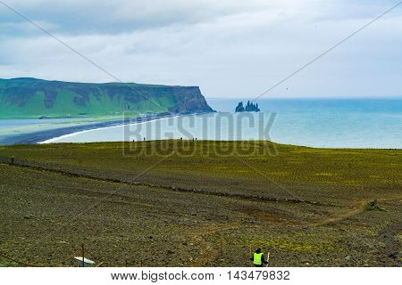 View of Famous Reynisdrangar rock formations from the cape Dyrholaey near the village of Vik in Iceland