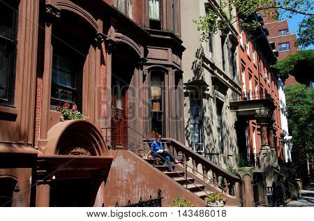 Brooklyn NY- August 13 2007: 19th century brownstones line the west side of Henry Street in the Brooklyn Heights historic district