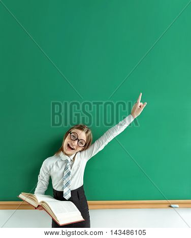 Young learner having good idea pointing finger up. Photo of teen schoolgirl creative concept with Back to school theme