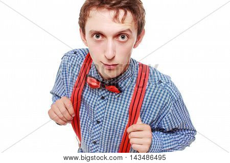 handsome guy raised an eyebrow. a young man in a plaid shirt, bow tie and red suspenders. surprised face. view from above, isolated on white background