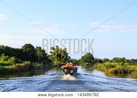 Local People On A Water Taxi In An Tropical Landscape In Africa