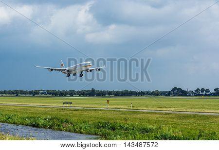 Schiphol Airport the Netherlands - August 20 2016: Surinam Airways Airbus A340-300 landing at Amsterdam Schiphol Airport