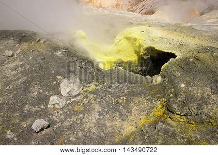 Yellow fumarole inside Mutnovsky Volcano crater, Kamchatka, Russia