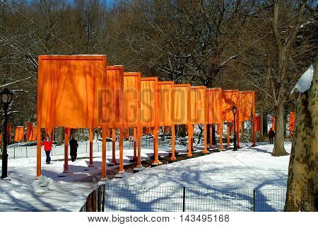 New York City - February 25 2005: Orange fabric panels comprise Christo's public art installation The Gates in Central Park