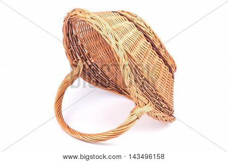 Empty wicker basket isolated on white. Selective focus.