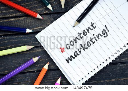 Contact Marketing text on notepad and colorful pencils