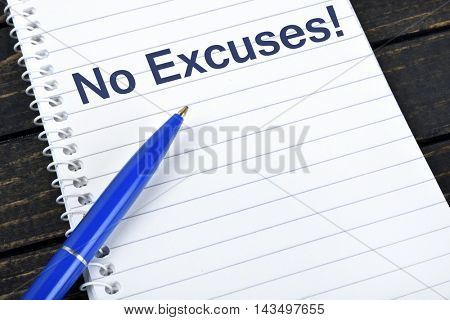No Excuses text on notepad and blue pen