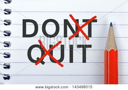 Don't quit text on notepad and red pencil