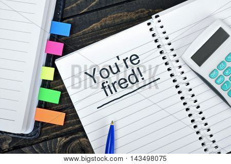 You're fired text on notepad and hand calculator