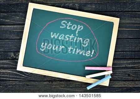 Stop wasting your time text on school board and chalk
