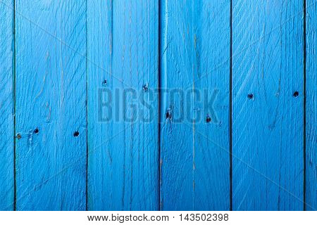 Vertical Blue Parallel Wooden Boards with Holes