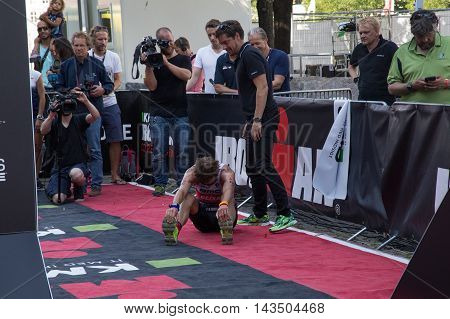 Copenhagen, Denmark - August 21, 2016: An exhausted Will Clarke who finished as 2nd in men's at the KMD Ironman Copenhagen 2016 in 07:59:31