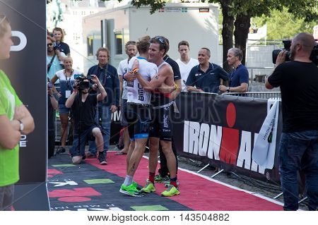 Copenhagen, Denmark - August 21, 2016: Winner Patrik Nilsson congratulating the 2nd Will Clarke in men's at the KMD Ironman Copenhagen 2016