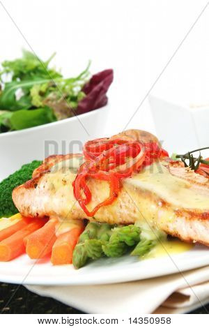 Salmon dinner ~ grilled salmon fillet with fresh asparagus, baby carrots, broccoli, cherry tomatoes, topped with red chili and bearnaise sauce.