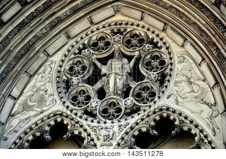 New York City - June 16 2013: West front center portal with carved Christ in Majesty window at Cathedral Church of St. John the Divine on Amsterdam Avenue