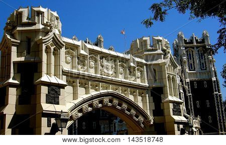 New York City - September 6 2004: Ornate neo-gothic arch decorated with crests spans Convent Avenue on the City College of New York campus in upper Manhattan