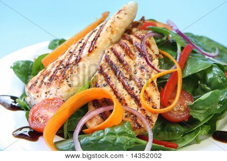 Grilled chicken breast with a spinach salad, with a balsamic reduction.
