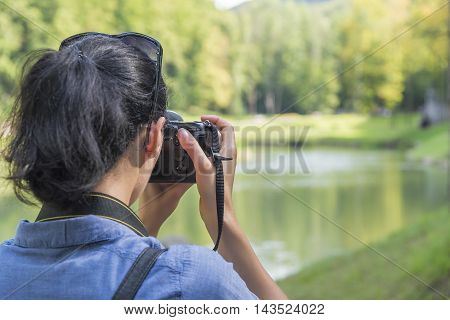 Photographer takes pictures in the nature or rural.