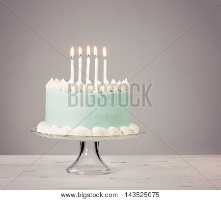 Blue Birthday Cake Over Grey Background.