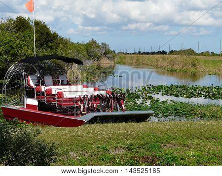 On a beautiful fall day, an airboat is ready to provide tours on a lake at a central Florida conservation area.