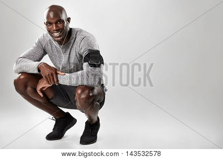 Smiling Young African Man On Grey Background