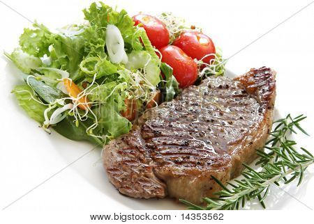 Grilled steak with salad.  Porterhouse or New York strip steak, grilled, with rosemary.
