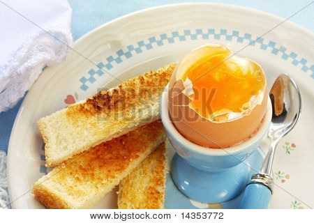 Soft-boiled egg in an eggcup, with toast