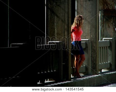 Attractive woman standing on the Blue Hill bridge in Maine