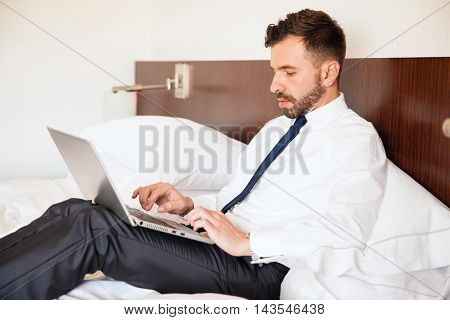 Businessman Working On A Hotel Bed
