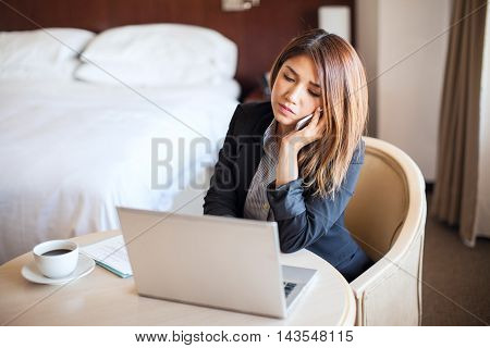 Female Lawyer Working In A Hotel Room