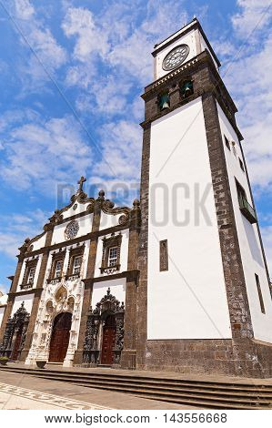 Church of Saint Sebastian (Igreja Matriz de Sao Sebastiao) in Ponta Delgada Sao Miguel Azores Portugal. Main church of Azores capital under high skies on sunny summer afternoon.