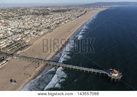Manhattan Beach, California, USA - August 16, 2016:  Afternoon aerial view of Manhattan Beach Pier in Los Angeles County, California.